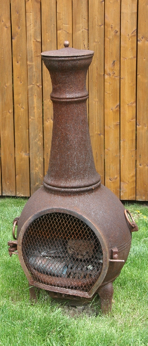 This Chiminea Should Have Been Placed On A Patio Stone Or Concrete Base.  There Is A Potential Danger Of The Unit Tipping Over If The Legs Sink Into  The ...