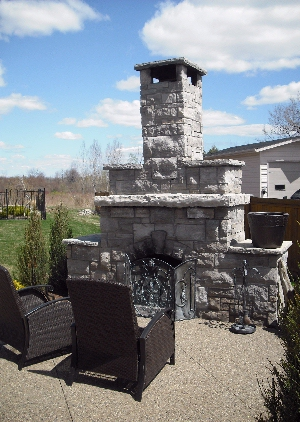 This Massive Outdoor Fireplace Blends In With The Poured Concrete, Pebble  Finished Patio. It Is Strictly Used As A Fireplace And Is Not Equipped With  A ...