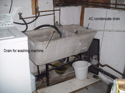 This double sink concrete laundry tub is showing its age